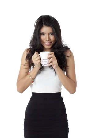 pinay: Pretty woman holding a white mug Stock Photo