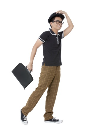 attache case: Portrait of a stylish Asian man holding a small attache case isolated on Stock Photo