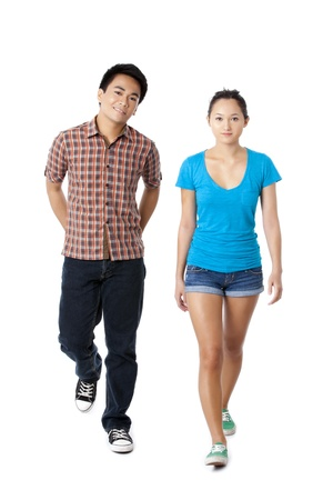 filipino ethnicity: Portrait of man and woman walking in a front view image Stock Photo