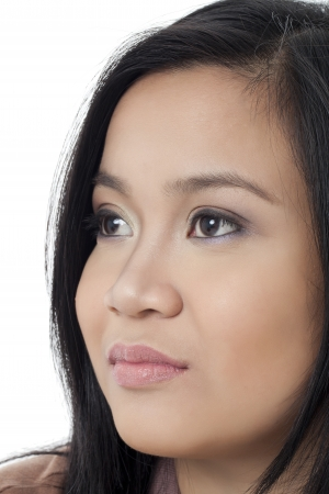 pinay: Close up image of face of a lady against white background Stock Photo