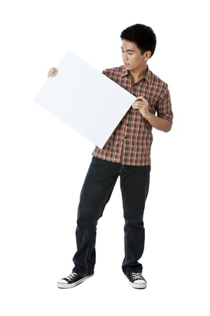 an Asian man modeling a white cardboard on a white background photo