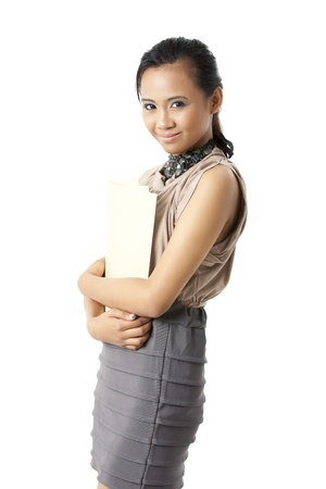 pinay: Image of a young Asian model in casual attire hugging folders in her arms isolated in a white background Stock Photo