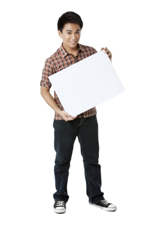 adolescent: Asian Teenager Man holding a white illustration board isolated on