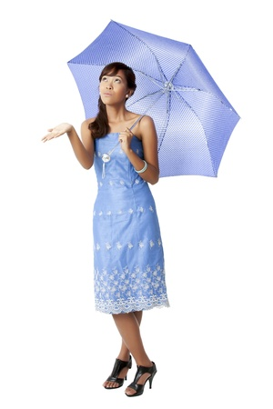 pinay: Portrait of attractive girl white blue umbrella against white background