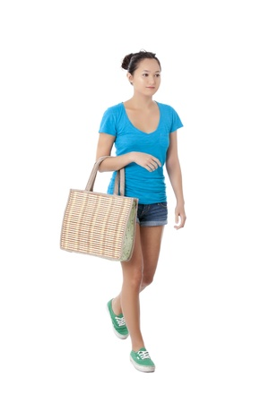pinay: Image of attractive  lady carrying bag against white background Stock Photo