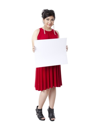 pinay: Portrait of a smiling lady wearing a red dress holding a blank white board