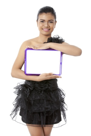 pinay: Close-up portrait of a pretty lady wearing a black dress holding a white slate board Stock Photo