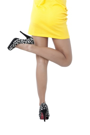 pinay: A lady in yellow dress and black high heels lifting her one leg
