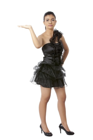 pinay: Portrait of a beautiful lady wearing a black dress raising her hand against the white background