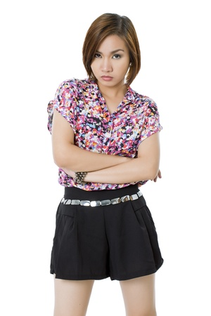 Close-up image of a lady with arm crossed standing on a white background Stock Photo