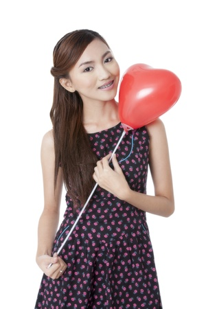 pinay: Close-up portrait of a pretty lady holding a red heart shape balloon
