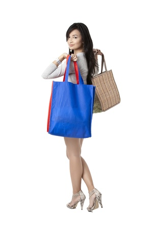 pinay: Image of a beautiful lady holding shopping bags while walking on a white background