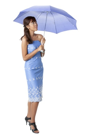 Portrait of a beautiful lady wearing a blue  dress holding an umbrella isolated on a white background
