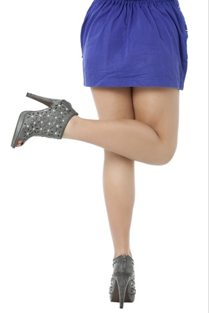 pinay: Image of a lovely lady in blue dress with pointed stiletto lifting her one leg