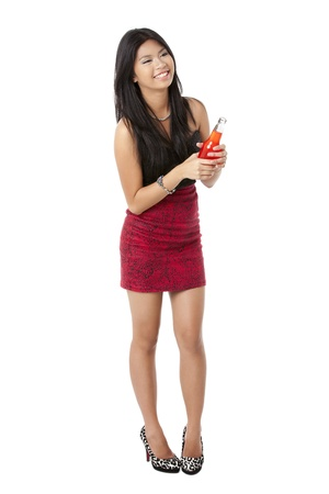 Portrait of a party woman in a red dress holding a beer over the white background photo