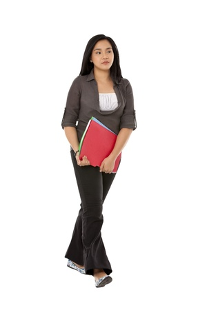pinay: A woman holding the files while walking over the white background Stock Photo