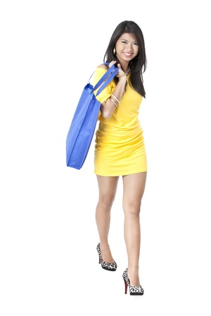Image of beautiful girl holding a shopping bag against white background Stock Photo - 17391667