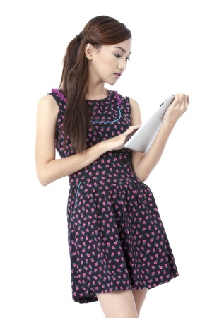 pinay: Portrait of beautiful girl using tablet pc against white background Stock Photo