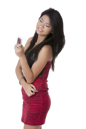 pinay: Portrait of beautiful lady looking to her phone with white background