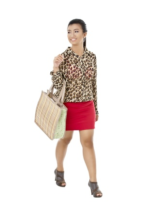 pinay: Portrait of a beautiful lady with bag looking to the side of a white background