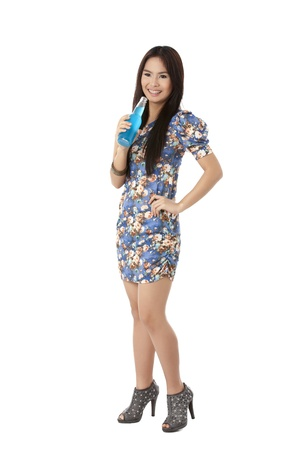 pinay: Smiling beautiful lady standing while holding a bottle alcohol drink