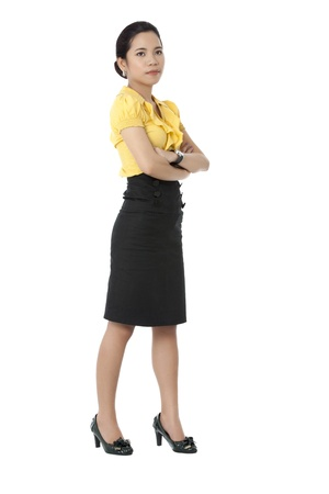 Image of a attractive Asian corporate woman posing with arms crossed against white background. Model: Novaliza T. Garcia photo