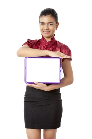 pinay: Close-up image of a cheerful lady holding a white slate board isolated on a white background Stock Photo