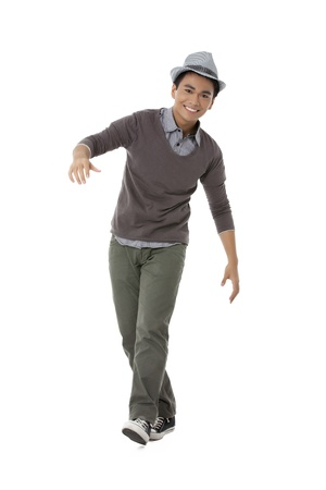teenage guy: Full length portrait of cheerful teenage guy against white background