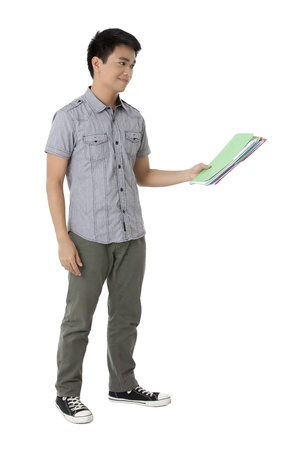 cute guy: Portrait of cute teenage guy holding folder against white background