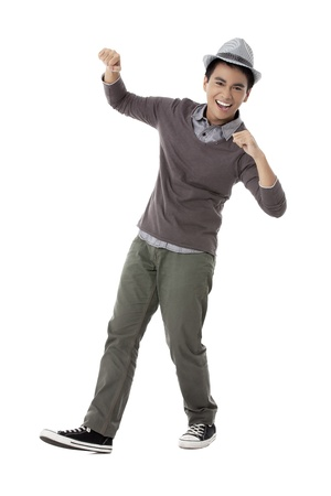 pinoy: Portrait of a dancing male teenager on a white background Stock Photo