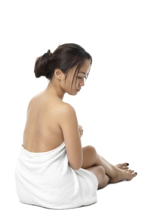 Rear view of a attractive female wrapped in towel on white surface. Model: Zhenith Dumaraos Stock Photo - 17391876