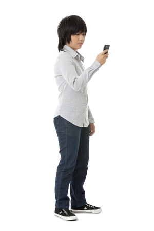 pinoy: Portrait of girl looking to her cell phone isolated on white background Stock Photo