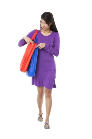 pinay: Portrait of girl with shopping bag against white background Stock Photo