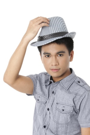 pinoy: Portrait of good looking guy holding his cap isolated on white background Stock Photo