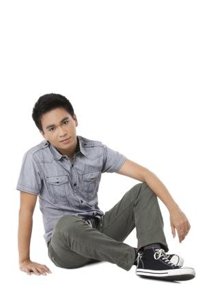 good looking teenage guy: Portrait of good looking teenage guy against white background