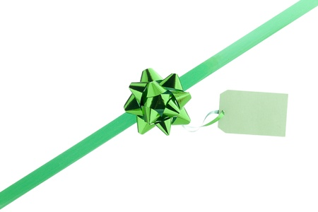 Green bow with a card in a white background Stock Photo - 17396006