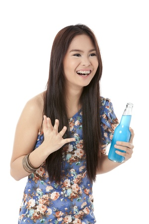 pinay: Happy beautiful lady holding bottle of drinks against white background