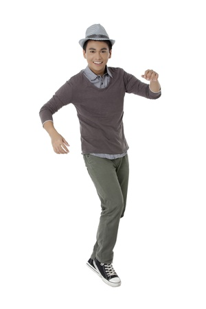 pinoy: Portrait of a happy male teenager dancing on a white background Stock Photo