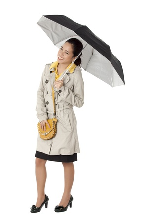 Image of a Asian young female wearing formal attire and holding an umbrella against plain white background. Model: Novaliza T. Garcia photo