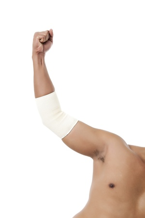 elbow pad: Image of human arms with elbow band against white background Stock Photo