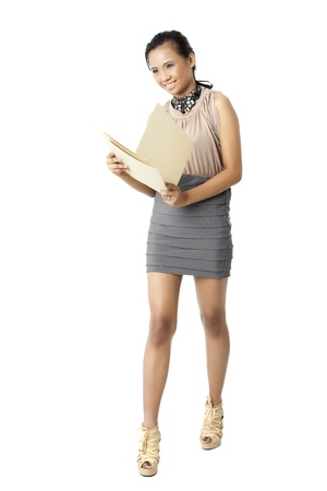Attractive young female with files and folders isolated on white background. Model: Geline Saculsan Stock Photo - 17422475