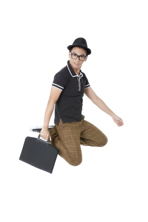 Jumping man in a hat while holding a briefcase over a white background photo