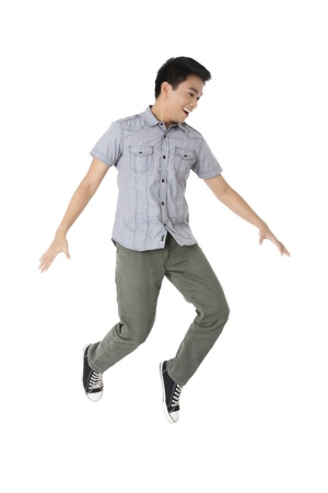 Portrait of a jumping young man isolated in a white background photo
