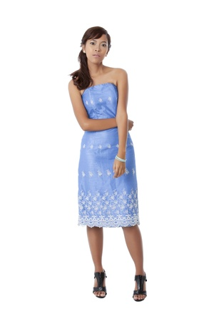 Portrait of lady wearing blue dress against white background