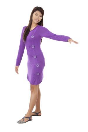 Portrait of lady wearing violet dress raising her hand against white background Stock Photo