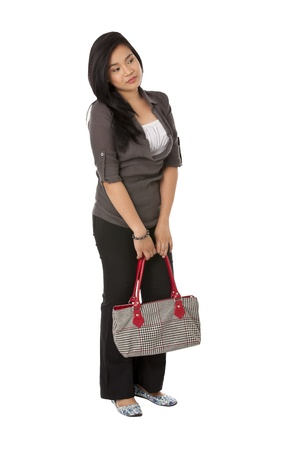 Portrait of standing lady with bag on white background photo
