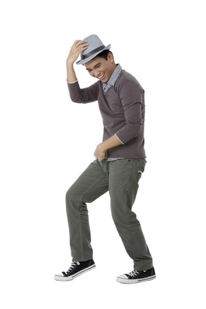 filipino ethnicity: Portrait of a male teenager showing Michael Jackson dance in a white surface
