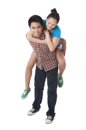 pinoy: Portrait of a sweet couple with man carrying her woman against white background