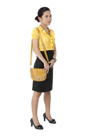 Portrait of office girl yellow bag isolated on white background photo