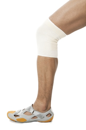 sleeve: Illustration of one leg having a knee sleeve and rubber shoe on a white back
